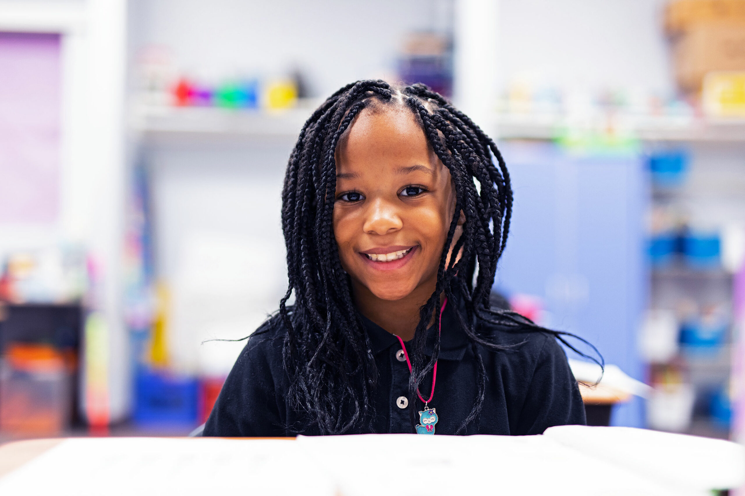 Smiling student in classroom.